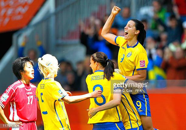 Jessica Landstrom Lotta Schelin and Caroline Seger celebrate the first goal by Lisa Dahlkvist of Sweden against Ri Un Hyang and Korea DPR during the...
