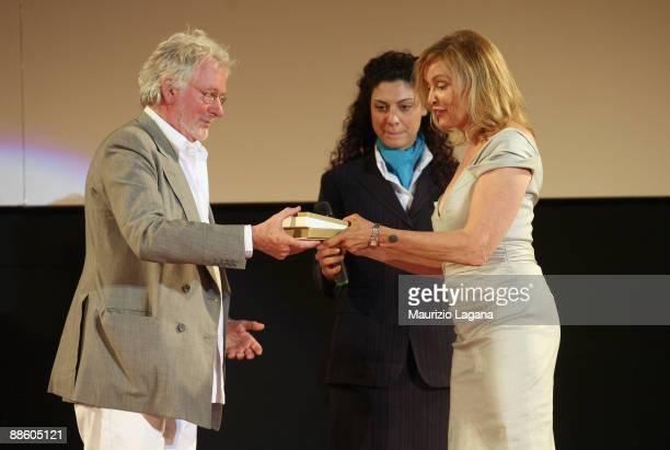 Jessica Lange receives the Taormina Art Award by Hugh Hudson during Taormina Film Fest on June 20 2009 in Taormina Italy