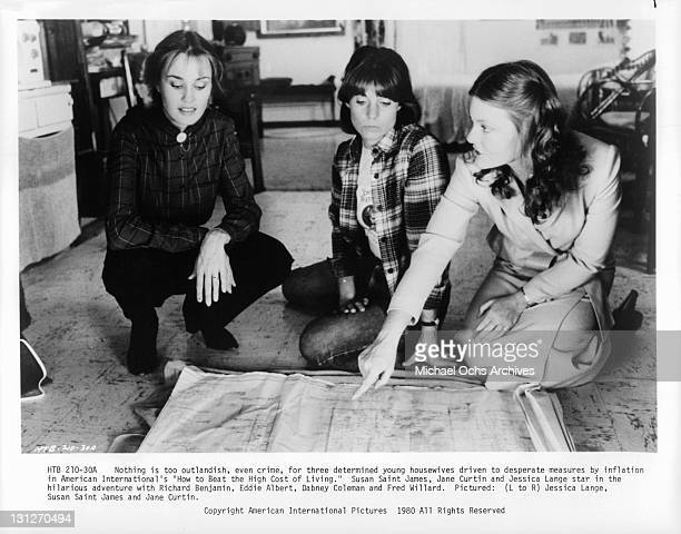 Jessica Lange Susan Saint James and Jane Curtin looking at map in a scene from the film 'How To Beat The High Cost Of Living' 1980