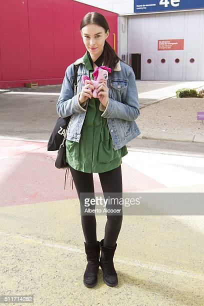 Jessica Le wears Other Stories Jersey Levis Jacket and Vintage pants during Mercedes Benz Fashion Week at Ifema on February 19 2016 in Madrid Spain