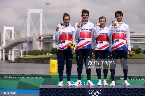 Jessica Learmonth, Jonathon Brownlee, Georgia Taylor-Brown and Alex Yee of Team Great Britain pose with their gold medals on the podium during the...