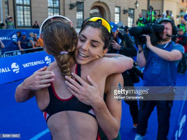 Jessica Learmonth of Great Britain and Ashleigh Gentle of Australia embrace after the women's elite race of the Vattenfall World Triathlon Stockholm...