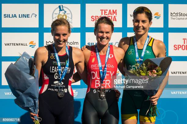 Jessica Learmonth of Great Britain Flora Duffy of Bermuda and Ashleigh Gentle of Australia on the winner's podium after the women's elite race of the...