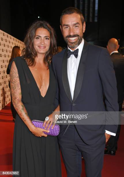 Jessica Lemarie and Robert Pires attend the GQ Men Of The Year Awards at the Tate Modern on September 5 2017 in London England