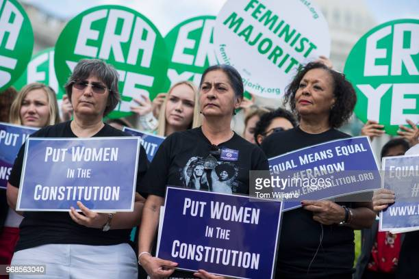 Jessica Lenahan center a domestic violence survivor and Carol Jenkins right of the Equal Rights Amendment Task Force attend a news conference at the...