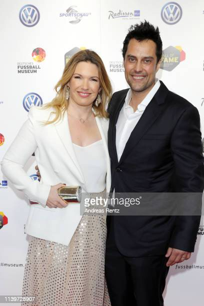 Jessica Libbertz and her husband Roman Libbertz attend the Hall Of Fame gala at Deutsches Fussballmuseum on April 01, 2019 in Dortmund, Germany.