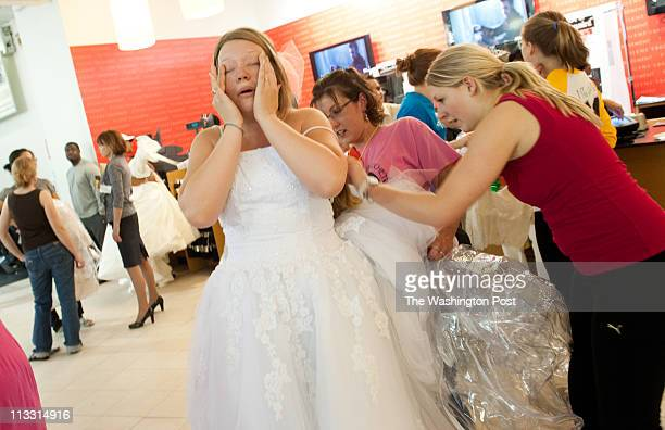 Jessica Lidh of Mechanicsville MD wipes the tears of joy from her eyes as she wears her dream dress The Running of the Brides at FileneÕs Basement...