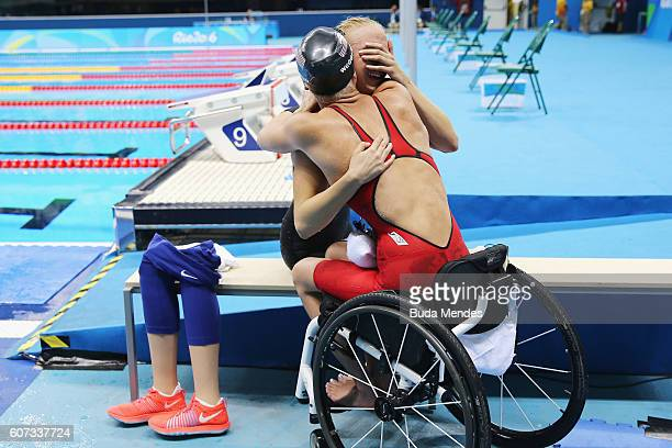 Jessica Long of the United States is congratulated by her team mate Mallory Weggemann of the United States after winning the gold medal in the...