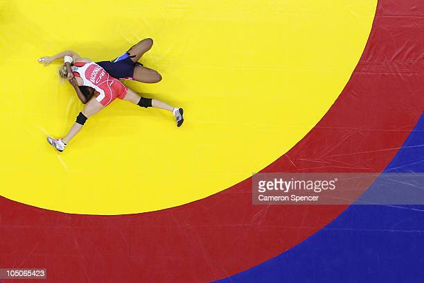 Jessica MacDonald of Canada competes against Mpho Madi of South Africa during the women's 51kg bronze wrestling at IG Sports Complex during day five...