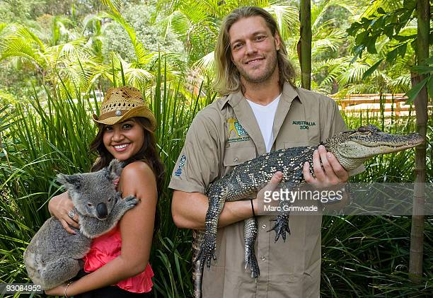 Jessica Mauboy cuddles a koala and WWE Superstar Edge nurses an alligator during Steve Irwin Day celebrations at Australia Zoo on November 15 2009 in...