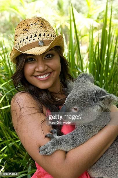 Jessica Mauboy cuddlles a koala during Steve Irwin Day celebrations at Australia Zoo on November 15 2009 in Sunshine Coast Australia