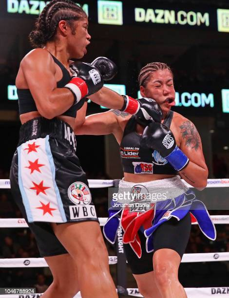 Jessica McCaskill lands a punch on Erica Anabella Farias on her way to winning the WBC World Female Super-Lightweight title at Wintrust Arena on...