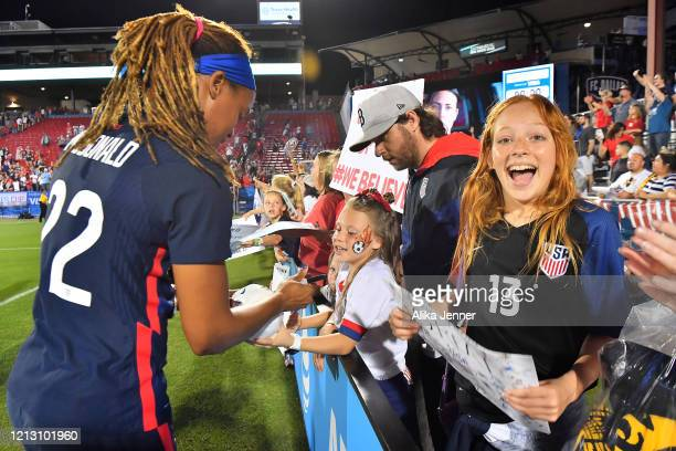 Jessica McDonald of the United States signs autographs after the SheBelieves Cup match against Japan at Toyota Stadium on March 11 2020 in Frisco...
