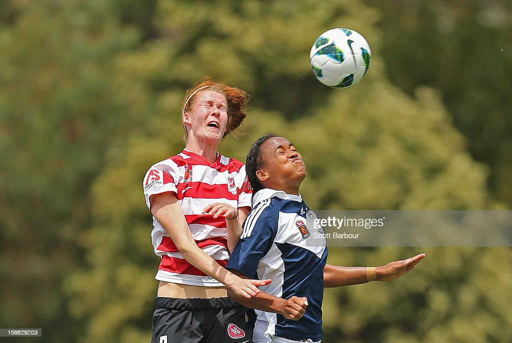 Jessica McDonald of the Victory and Alesha Clifford of the Wanderers compete for the ball during the round 10 W-League match between the Melbourne Victory and the Western Sydney Wanderers at Wembley Park on December 22, 2012 in Melbourne, Australia.