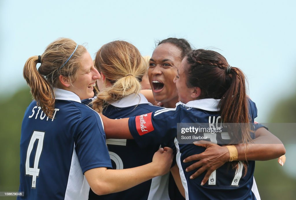 Jessica McDonald of the Victory celebrates with her team mates after scoring her second goal during the round 10 W-League match between the Melbourne Victory and the Western Sydney Wanderers at Wembley Park on December 22, 2012 in Melbourne, Australia.
