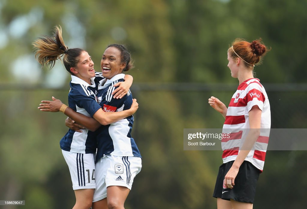 Jessica McDonald (C) of the Victory is congratulated by Enza Barilla after scoring her first goal during the round 10 W-League match between the Melbourne Victory and the Western Sydney Wanderers at Wembley Park on December 22, 2012 in Melbourne, Australia.