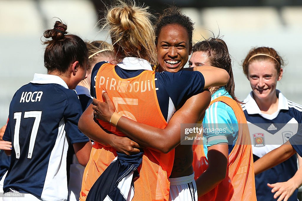 Jessica McDonald of the Victory is congratulated by Laura Spiranovic after kicking the winning penalty during the W-League Semi Final match between Perth Glory and Melbourne Victory at nib Stadium on January 20, 2013 in Perth, Australia.