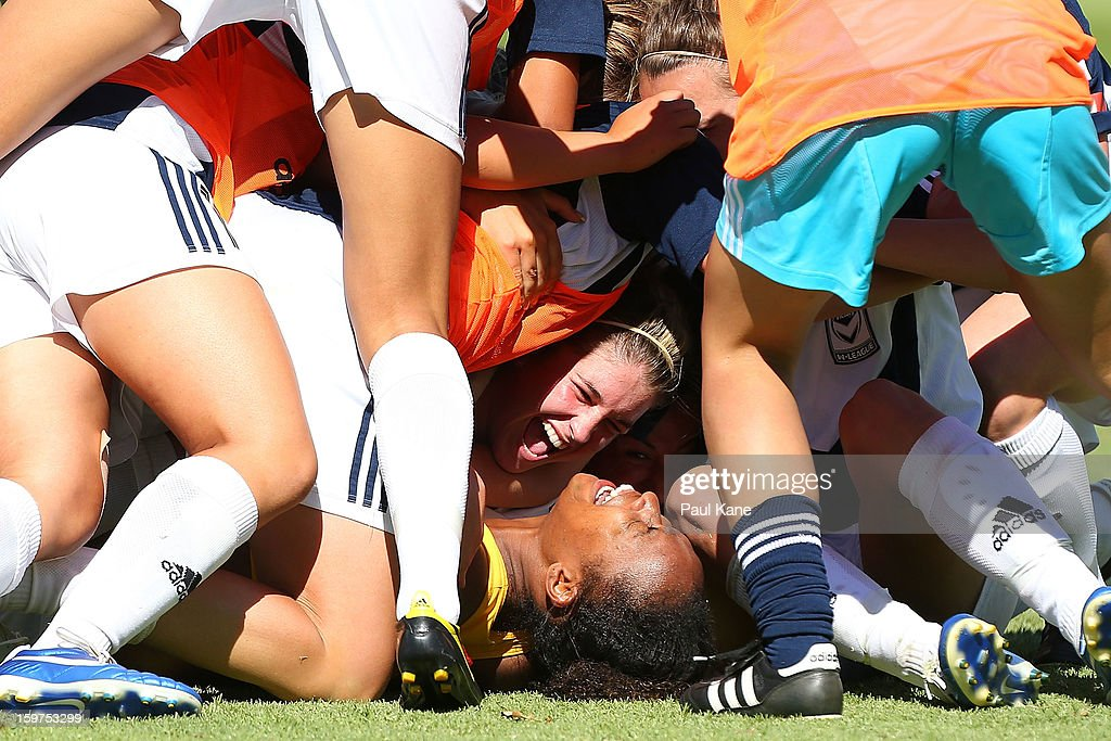 Jessica McDonald of the Victory is congratulated by team mates after kicking the winning penalty during the W-League Semi Final match between Perth Glory and Melbourne Victory at nib Stadium on January 20, 2013 in Perth, Australia.