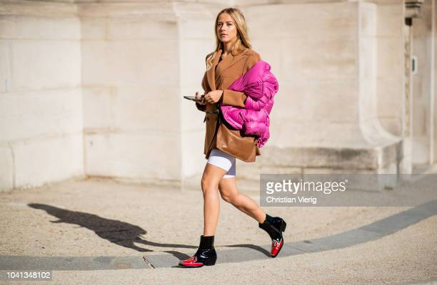 Jessica Mercedes Kirschner wearing pink puffer jacket is seen outside Maison Margiela during Paris Fashion Week Womenswear Spring/Summer 2019 on...