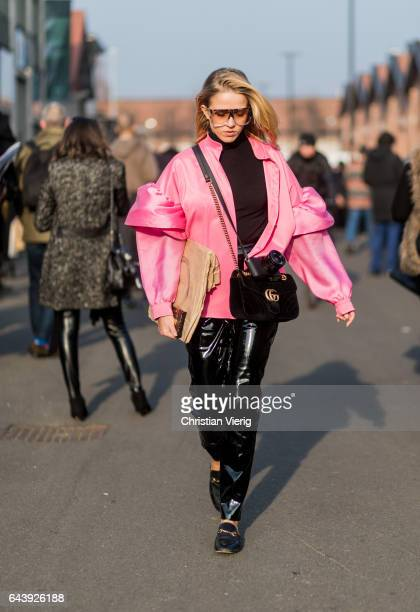 Jessica Mercedes wearing a pink jacket pvc pants Gucci bag outside Gucci on February 22 2017 in Milan Italy