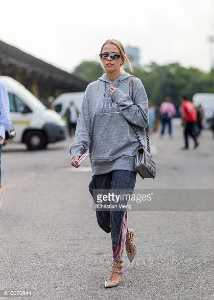 Jessica Mercedes wearing grey hoody Chanel bag and Valentino shoes outside Diesel during Milan Fashion Week Spring/Summer 2017 on September 23 2016...