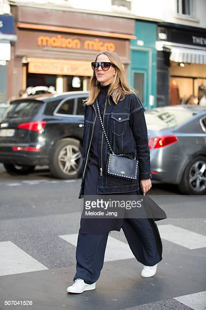 Jessica Mercedes wears an allblue outfit with Celine sunglasses a Valentino purse denim And Other stories jacket Zara dress and Adidas sneakesr at...