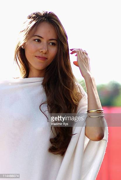 Jessica Michibata girlfriend of Jenson Button of Great Britain and McLaren walks in the paddock following practice for the Spanish Formula One Grand...