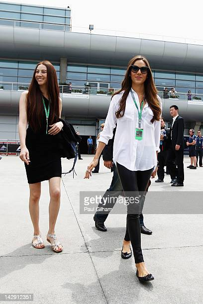 Jessica Michibata girlfriend of Jenson Button of Great Britain and McLaren arrives in the paddock with her younger sister Angelica Michibata before...