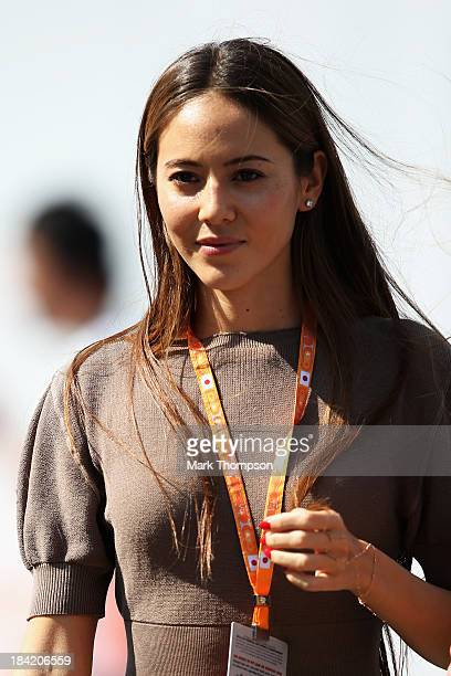 Jessica Michibata girlfriend of Jenson Button of Great Britain and McLaren walks in the paddock following qualifying for the Japanese Formula One...