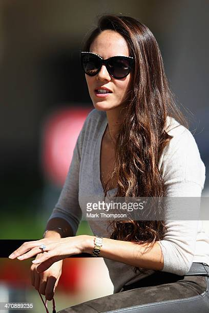 Jessica Michibata girlfriend of Jenson Button of Great Britain and McLaren sits in the paddock during day three of Formula One Winter Testing at the...