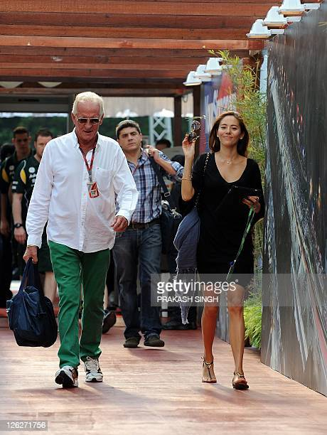 Jessica Michibata the girlfriend of McLarenMercedes driver Jenson Button of Britain arrives in the paddock prior to the third practice session of...