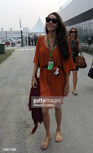 Jessica Michibata the girlfriend of McLarenMercedes driver Jenson Button of Britain arrives in the paddock prior to the first practice session of...