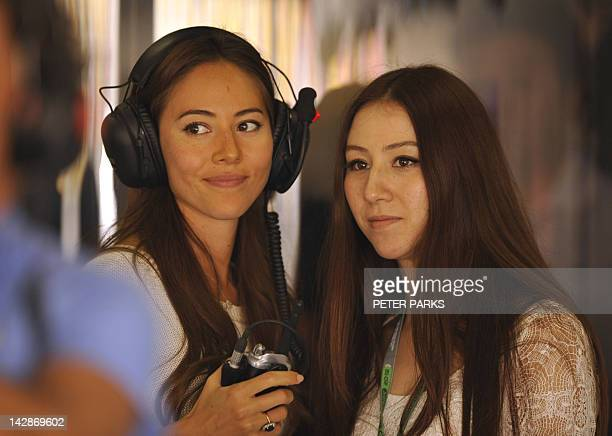 Jessica Michibata the girlfriend of McLarenMercedes driver Jenson Button of Britain and her sister Angelica visit the garage during the third...