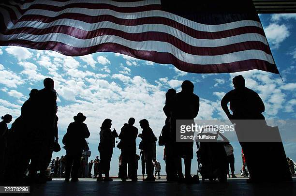 Jessica Miller and her son Samuel wave along with Rosa Garcia during a homecoming celebration at Miramar Marine Corps Air Station September 9 2004in...
