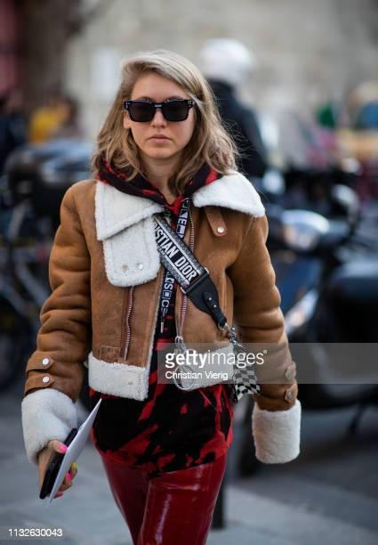 Jessica Minkoff is seen wearing brown shearling jacket red pants outside Lanvin during Paris Fashion Week Womenswear Fall/Winter 2019/2020 on...