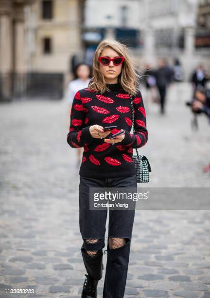 Jessica Minkoff is seen wearing ripped denim jeans outside Thom Browne during Paris Fashion Week Womenswear Fall/Winter 2019/2020 on March 03 2019 in...