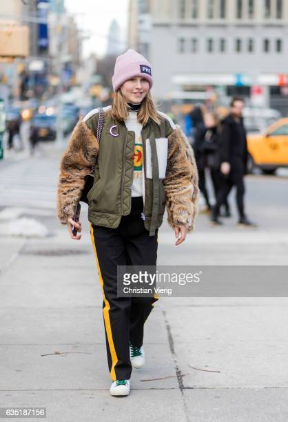 Jessica Minkoff wearing a bomber jacket with fur sleeves jogger pants outside 31 Phillip Lim on February 13 2017 in New York City