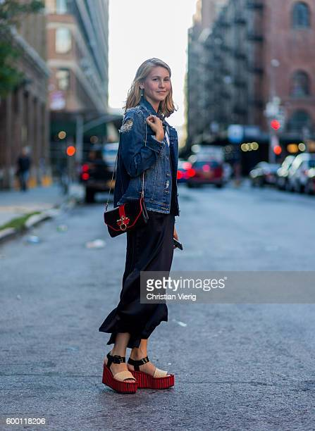 Jessica Minkoff wearing a denim jacket Givenchy bag black dress and platform sandals outside R13 on September 7 2016 in New York City