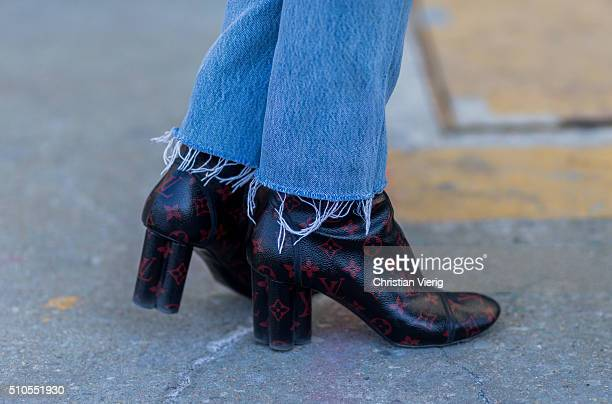 Jessica Minkoff wearing black Louis Vuitton boots with red print seen outside J Crew during New York Fashion Week Women's Fall/Winter 2016 on...