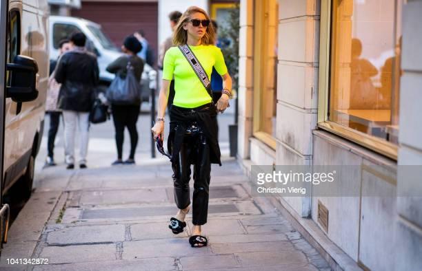 Jessica Minkoff wearing neon tshirt latex pants is seen outside Mugler during Paris Fashion Week Womenswear Spring/Summer 2019 on September 26 2018...