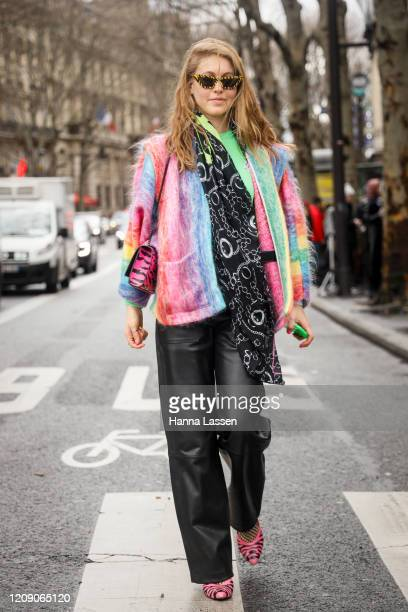 Jessica Minkoff wearing pastel colour mixed jacket, black leather pants, pink zebra heels, black acarf and pink zebra printed leather bag outside the...