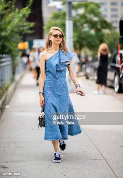 Jessica Minkoff wearing ripped off denim dress Dior saddle bag is seen outside SelfPortrait during New York Fashion Week Spring/Summer 2019 on...