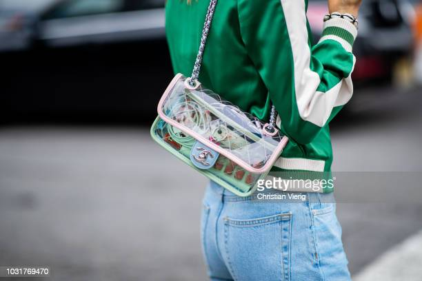 Jessica Minkoff wearing see trough Chanel bag denim jeans green jacket is seen outside Oscar de la Renta during New York Fashion Week Spring/Summer...