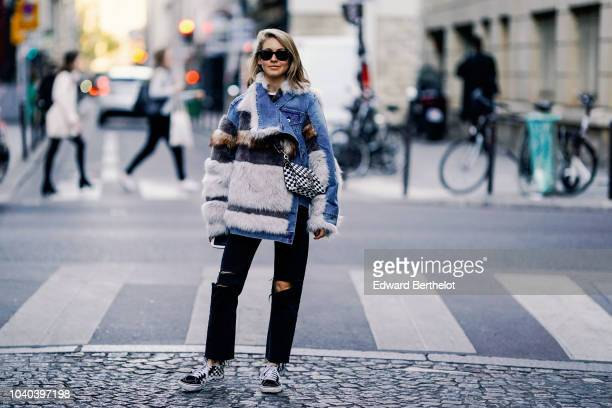 Jessica Minkoff wears sunglasses a blue and white fluffy coat black ripped jeans outside Ellery during Paris Fashion Week Womenswear Spring/Summer...