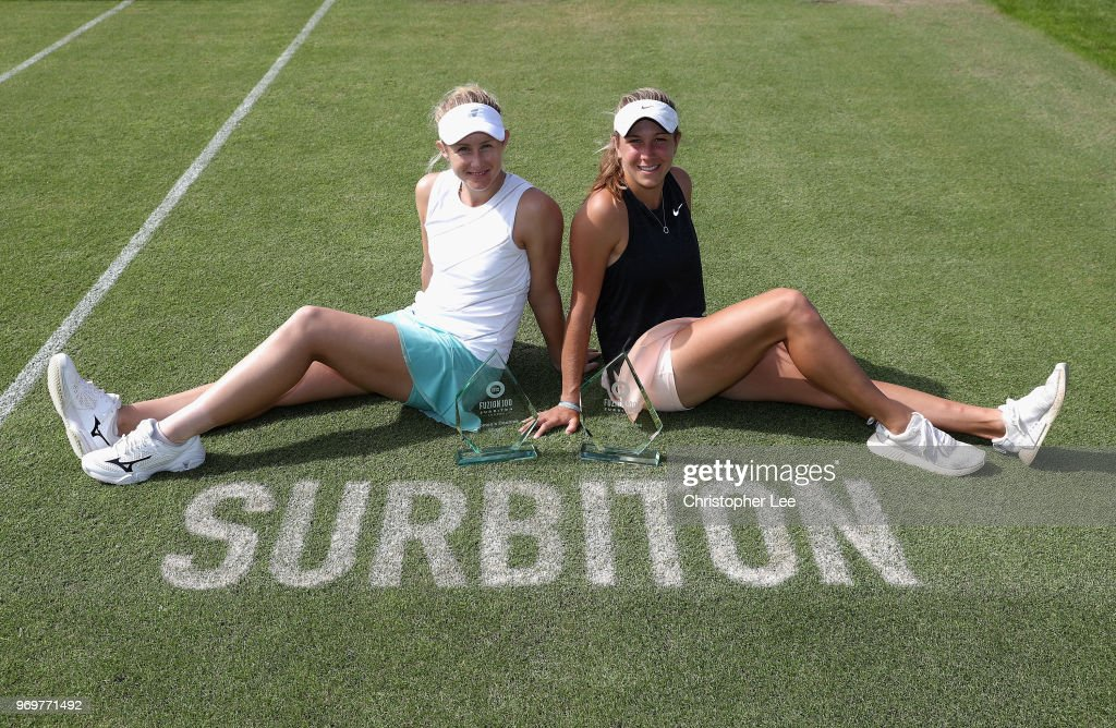 Jessica Moore (L) and Ellen Perez of Australia pose for the camera after their victory over Arina Rodionova and Yanina Wickmayer in the Womens Doubles Final on Day 7 of the Fuzion 100 Surbition Trophy on June 8, 2018 in London, United Kingdom.