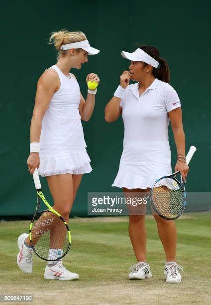 Jessica Moore of Australia and Akiko Omae of Japan speak during the Ladies Doubles first round match against Catherine Bellis of the United States...