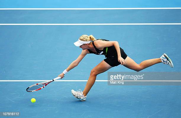 Jessica Moore of Australia runs to the net during her 1st round qualifying match against Olivia Sanchez of France during the Moorilla Hobart...