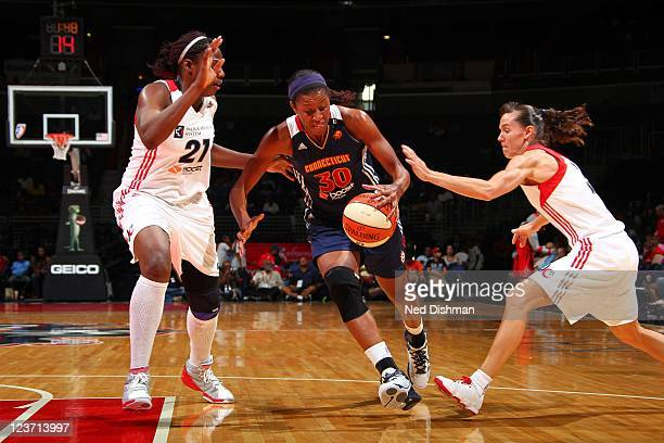 Jessica Moore of the Connecticut Sun drives against Kelly Miller of the Washington Mystics at the Verizon Center on September 4 2011 in Washington DC...