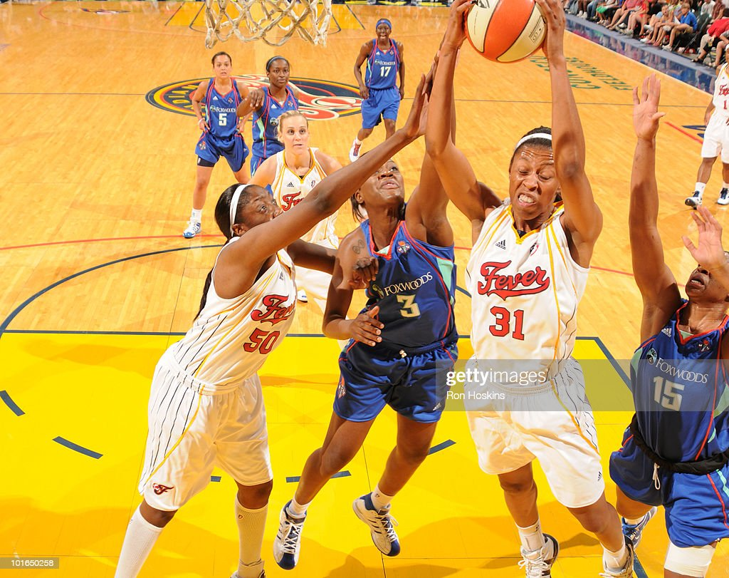 Jessica Moore #31 of the Indiana Fever battles Kia Vaughn #15 and Tiffany Jackson #3 of the New York Liberty at Conseco Fieldhouse on June 5, 2010 in Indianapolis, Indiana.