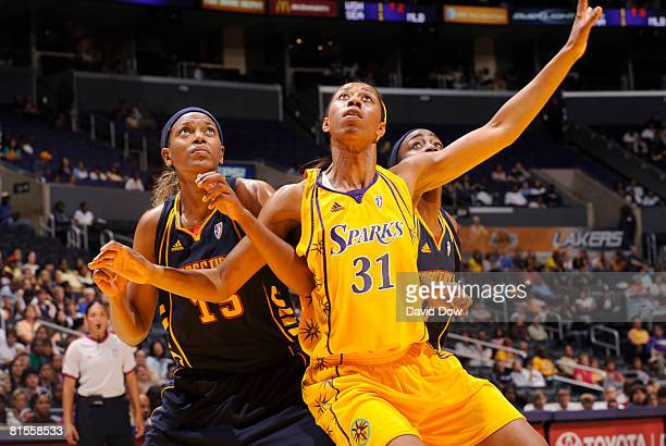 Jessica Moore of the Los Angeles Sparks boxes out on Asjha Jones of the Connecticut Sun at Staples Center on June 13 2008 in Los Angeles California...